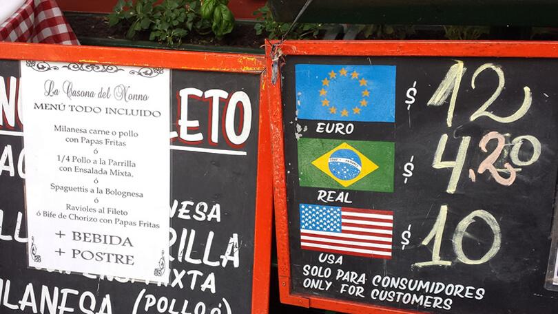 melhor moeda para usar na argentina